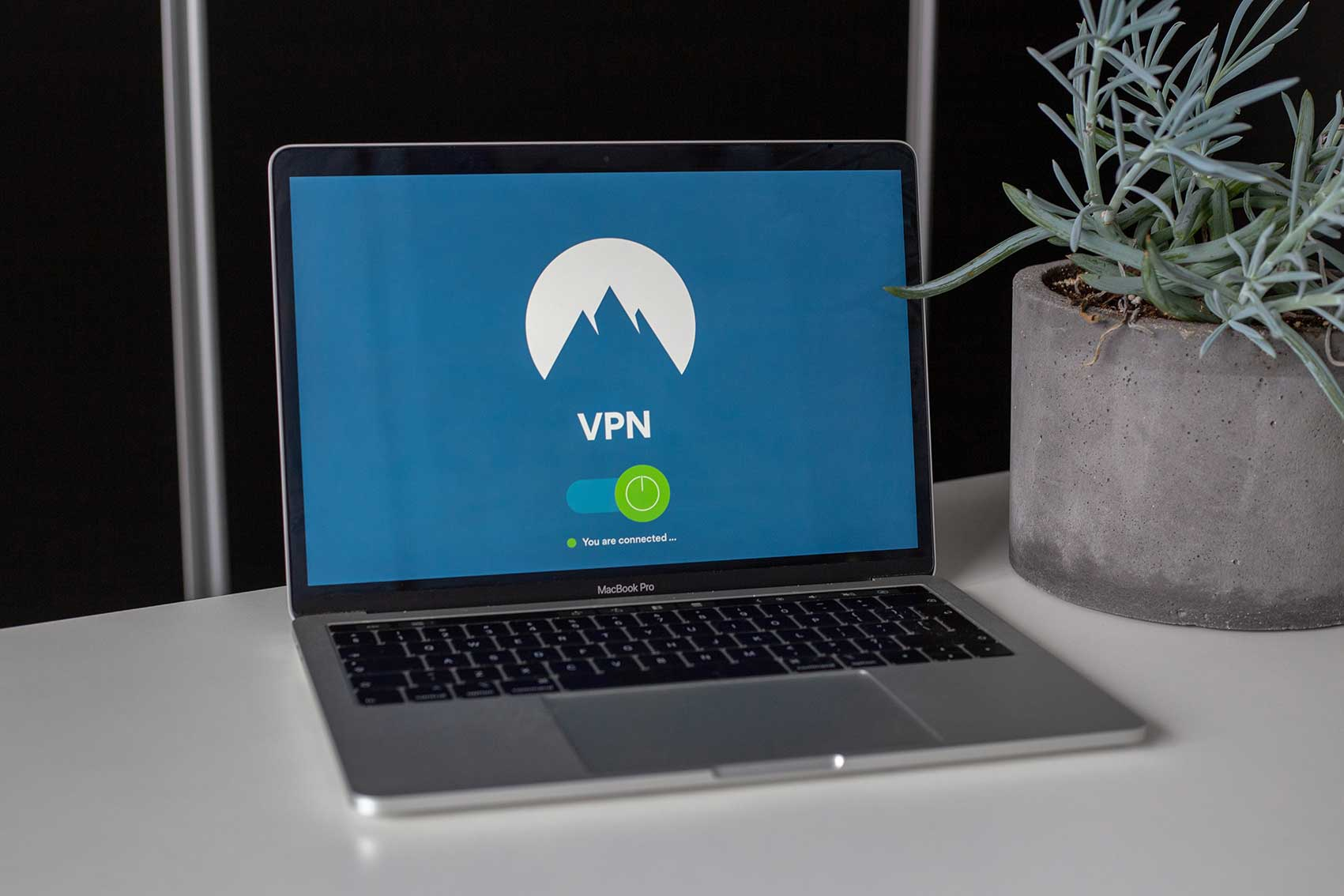 grey-and-black-macbook-pro-showing-vpn-2064586